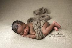 african american newborn boy mohair wrap side lying newborn photo neutral backdrop